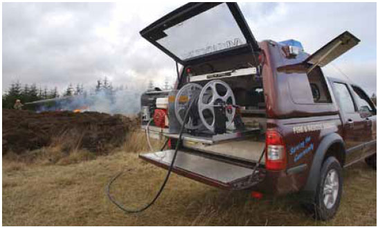 Photo B8.1 A photograph of a wildfire vehicle equipped with a fogging unit which can provide water support to hand crews