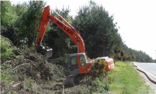 Photo B8.9 Heavy machinery being used to clear scrubland