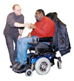 Man in a wheelchair chatting to another man