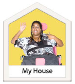 Woman in a wheelchair with the words My House at the bottom