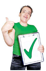 Woman holding a clipboard with a green tick on it
