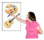 Woman pointing to a poster with a paint pallet and a guitar on it