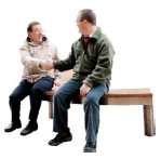 Two men sitting on a bench shaking hands