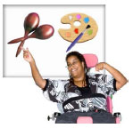 Woman in a wheelchair pointing to a poser with a paint pallet and maracas on it