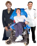 Health profesionals and a boy in a wheelchair