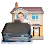 Man with a suitcase infront of a house