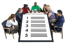 People sitting round a table with a checklist