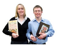 Two people holding books
