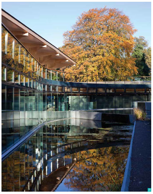 Image 15: building and trees reflecting in water