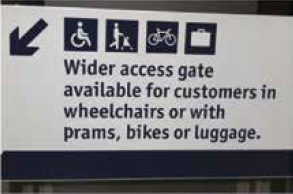 Wider access gate sign at Waverley Station