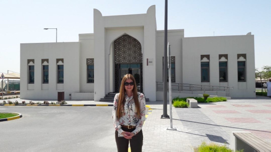 Jenny Steele, SWI consultant outside the newly constructed Ashgal customer service building in Doha, Qatar where she has developed new customer processes and systems with client.