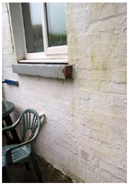 Photo 3: Extension wall construction showing thickness of wall. Condensation is visible on inside of kitchen window
